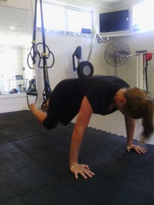 A version of a push up with your feet in the TRX... only for the Mad