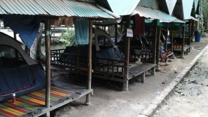 """Our tents lined up in little """"fale's"""" , as we had done 2 nights of rain and expected more"""