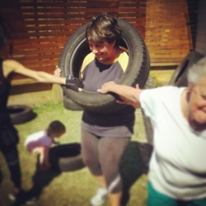 Carrying a tyre: either on one shoulder, in one hand, around the neck or out in front of you. This exercise mimics what life is like when you have to move a heavy object from one place to another!